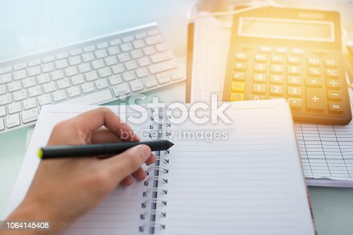 865596966istockphoto Investment theme stockmarket and finance business analysis stockmarket with digital tablet 1064145408