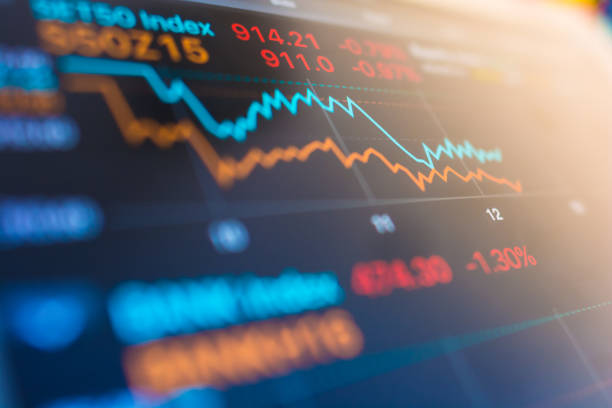 Investment theme stockmarket and finance business analysis stockmarket with digital tablet stock photo