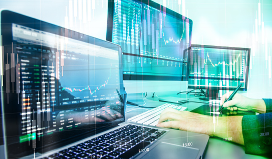 Investments in the stock market. Investor analyzes and buys shares in joint-stock companies. Increasing income through investments. Double exposure.