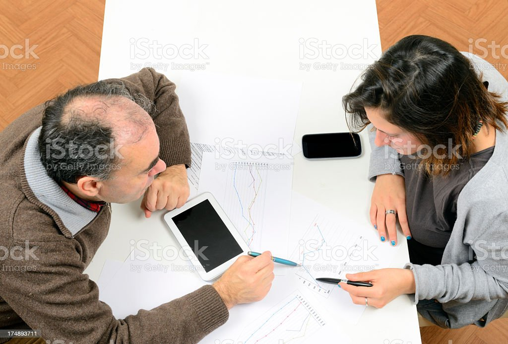Investments W Digital Tablet royalty-free stock photo