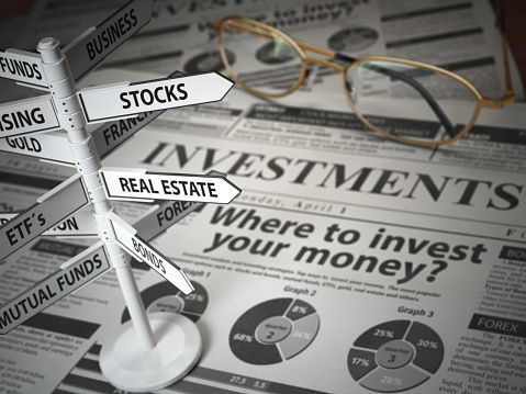 istock Investmments and asset allocation concept. Where to Invest? Newspaper and direction sign with investment options. 1072585234