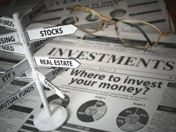 investmments and asset allocation concept. where to invest? newspaper and direction sign with investment options. - investment stock pictures, royalty-free photos & images