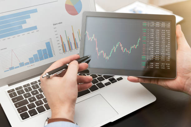 Investor, advisor showing chart on tablet stock photo