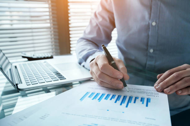 investor analyzing finance estimation charts, financial analytics stock photo