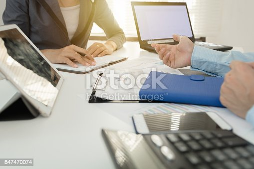 858031152istockphoto Investor executive discussing plan financial graph data on office table with laptop and tablet, finance, accounting, investment, meeting. 847470074