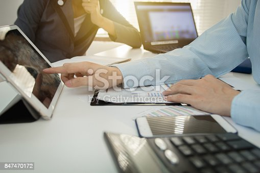 858031152istockphoto Investor executive discussing plan financial graph data on office table with laptop and tablet, finance, accounting, investment, meeting. 847470172