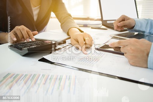858031152istockphoto Investor executive discussing plan financial graph data on office table, finance, accounting, investment, meeting. 857630996