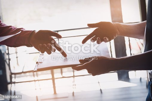 istock Investor or Analyst or Consultants or economist concept. Businessmen and partners are discussing to find a conclusion in the stock market. 1169195871
