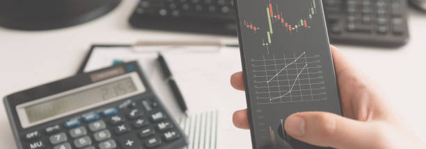 Investor using stock market trading mobile app stock photo