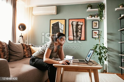 Woman working from home due to restrictive measures, lockdown and quarantine due to pandemic Coronavirus