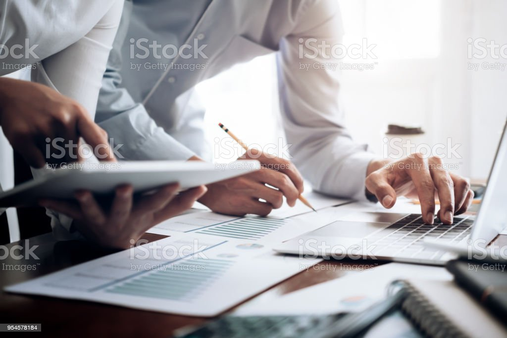 Investor working new startup project. Business team present. Investor working new startup project. Finance meeting. Adult Stock Photo