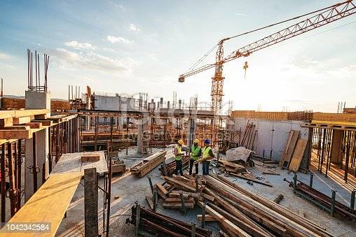 istock Investors and contractors on construction site 1042342584