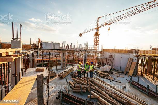 Investors and contractors on construction site picture id1042342584?b=1&k=6&m=1042342584&s=612x612&h=8ygktd7shquysctp3kwboiuepp64rbo03 c0cq0kgka=