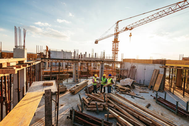 Investors and contractors on construction site stock photo