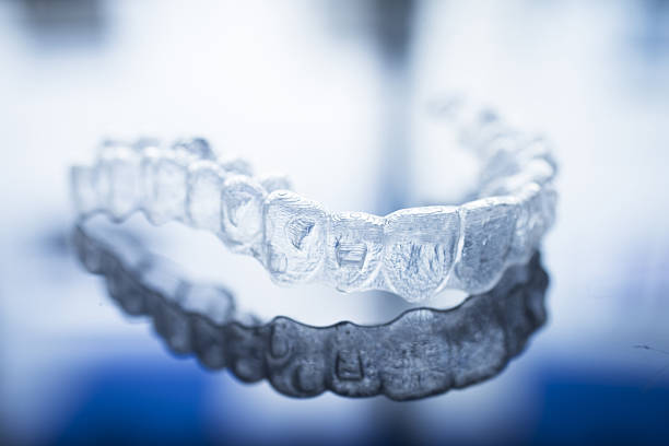 Invisible dental teeth brackets aligners braces retainers stock photo