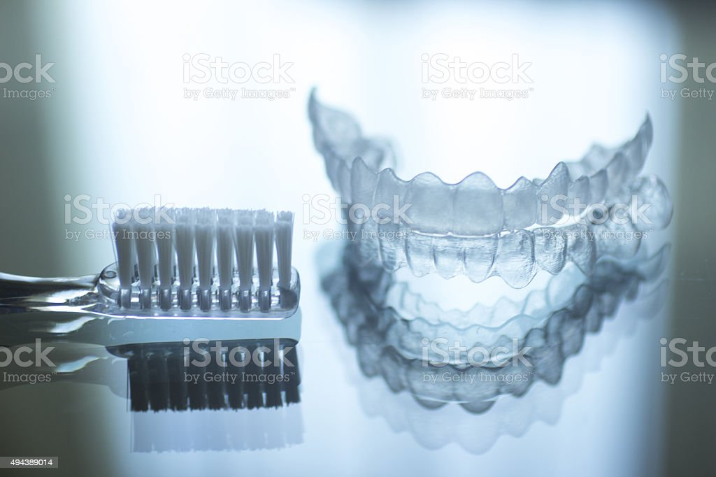 Invisible dental teeth brackets aligners retainers and toothbrush stock photo