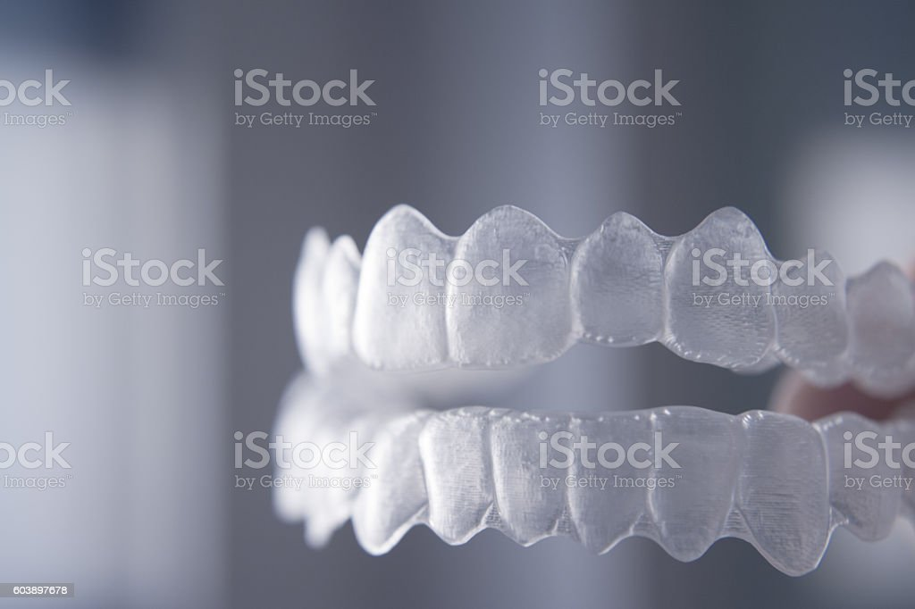 Invisible dental teeth brackets stock photo