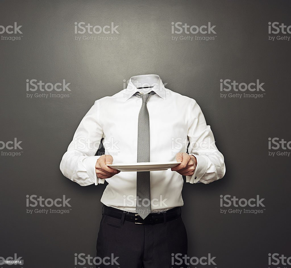 invisible man holding empty plate stock photo
