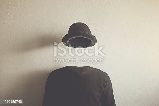 invisible man wearing black bowler, surreal concept of absence of identity