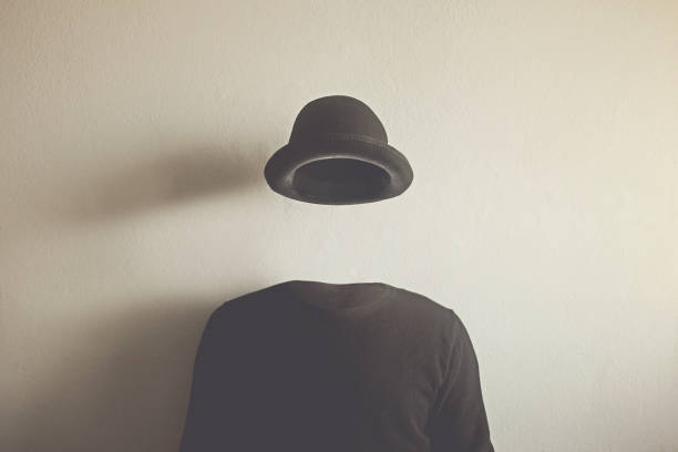 invisible man wearing black bowler, surreal concept of absence of identity stock photo