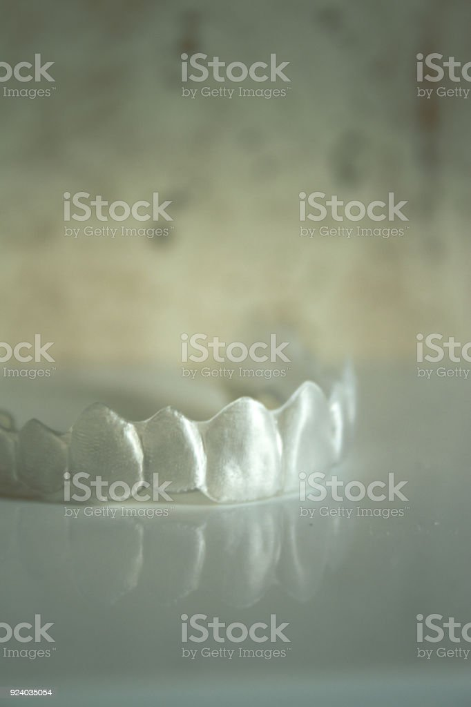 Invisible orthodontics reflected on the surface stock photo