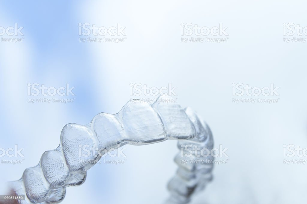Invisible orthodontics to align the teeth stock photo