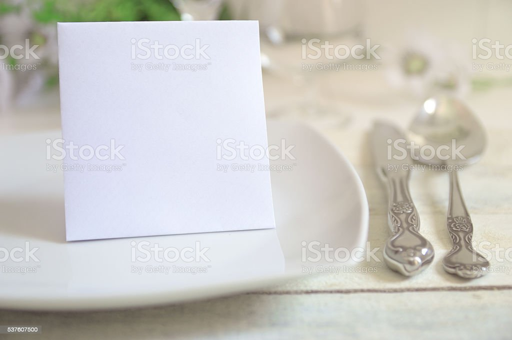 Invitation card on a decorated table stock photo