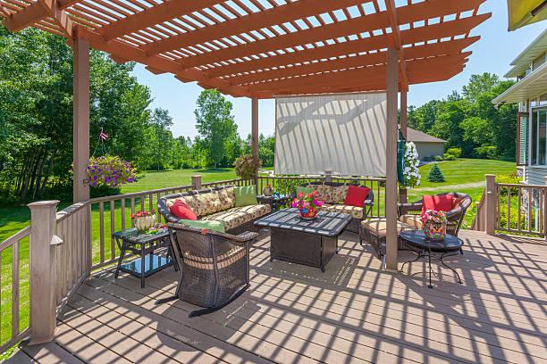 Inviting Backyard Patio Deck With Pergola stock photo