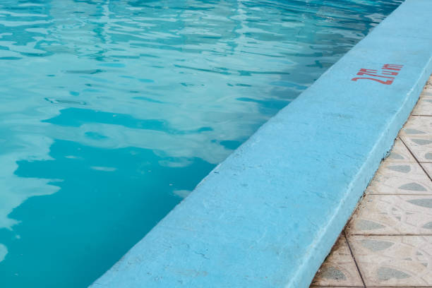 Inviting blue pool with 2.70m depth marking stock photo