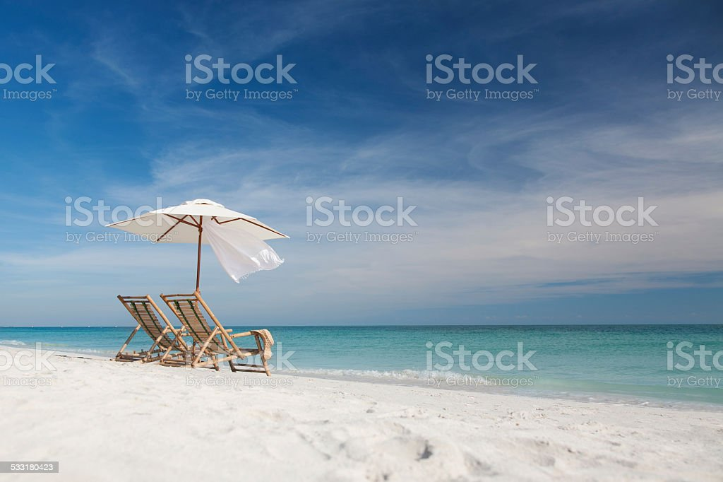 inviting chairs with umbrella on a beach in Florida, USA stock photo