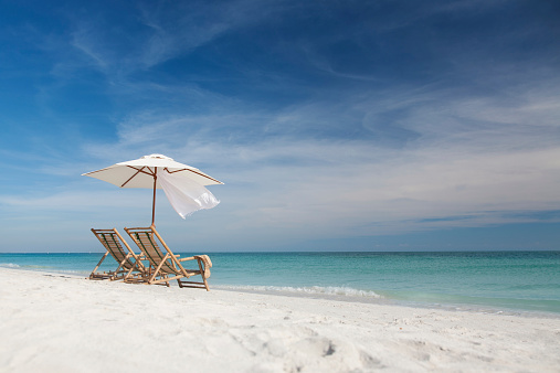 Inviting Chairs With Umbrella On A Beach In Florida Usa