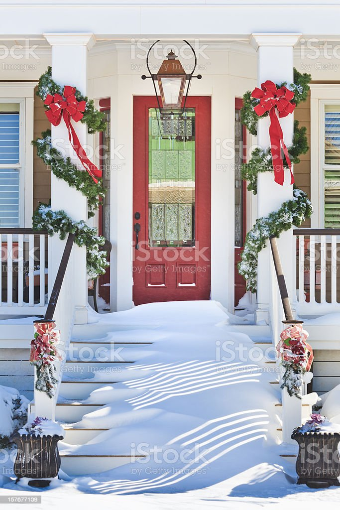 inviting front doorway with snowy Chrismas porch royalty-free stock photo