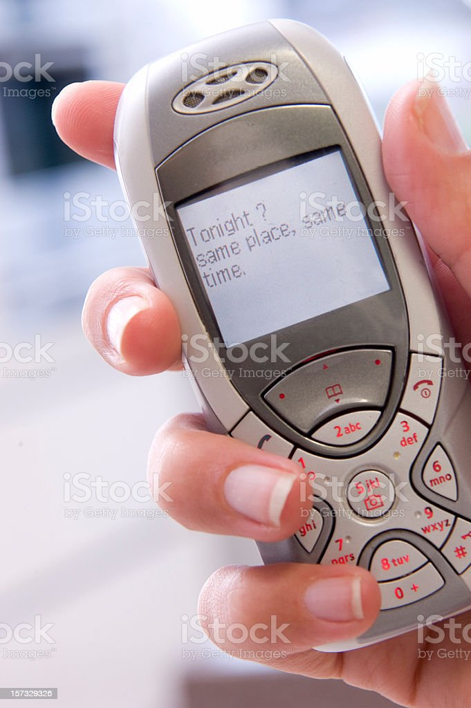 inviting message on mobile phone royalty-free stock photo