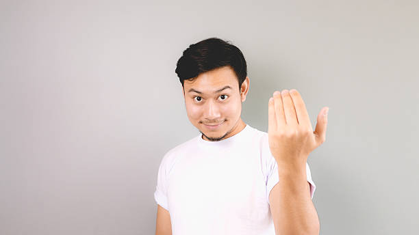 Inviting or calling hand sign. stock photo