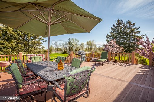 istock Inviting Rural Deck and Back Yard in Springtime 474283564