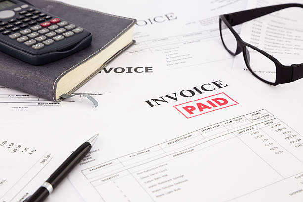 invoice and bills with paid stamp - paid stock pictures, royalty-free photos & images