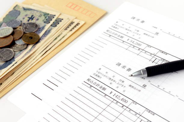 Invoice in Japanese and ballpoint pen stock photo