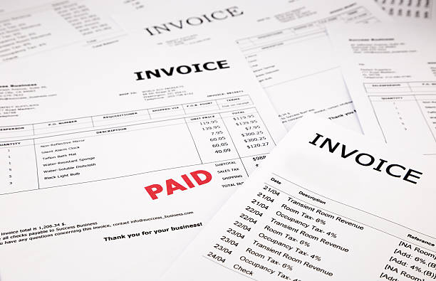 invoices and bills with paid stamp - paid stock pictures, royalty-free photos & images
