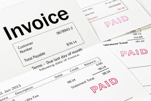 Invoices with Paid Stamp stock photo