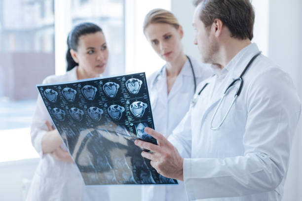 Involved radiographs discussing computed tomography result in the clinic stock photo