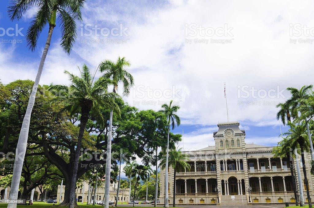 Iolani Palace and palm trees in Honolulu, HI stock photo