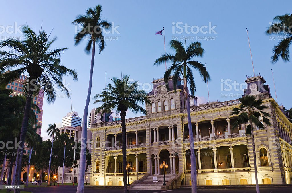 Iolani Palace at night in Honolulu, HI stock photo