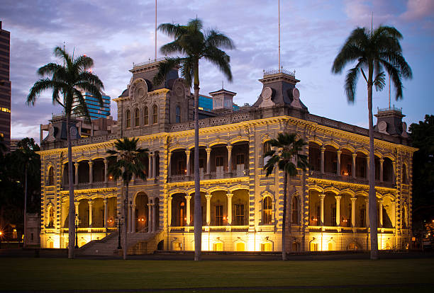 Iolani Palace at night in Honolulu, HI stock photo