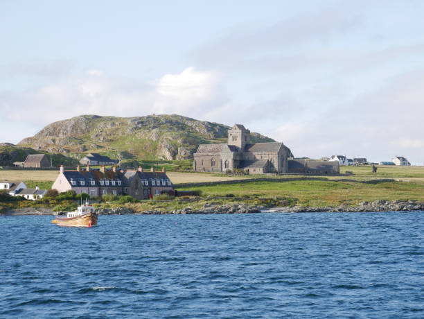 Iona Abbey Iona Abbey, cottages and a fishing boat on a sunny day in Autumn in 2017 from the Sound of Iona. abbey monastery stock pictures, royalty-free photos & images