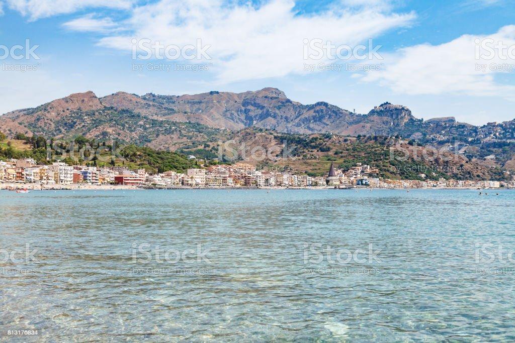 Ionian sea and view of Giardini Naxos town stock photo