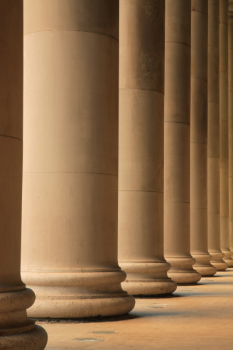 istock Ionic columns forming portico outside a train station 115931923