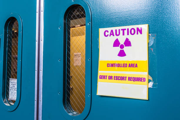 Ionizing radiation warning symbol displayed at the entrance to a laboratory; Message posted: