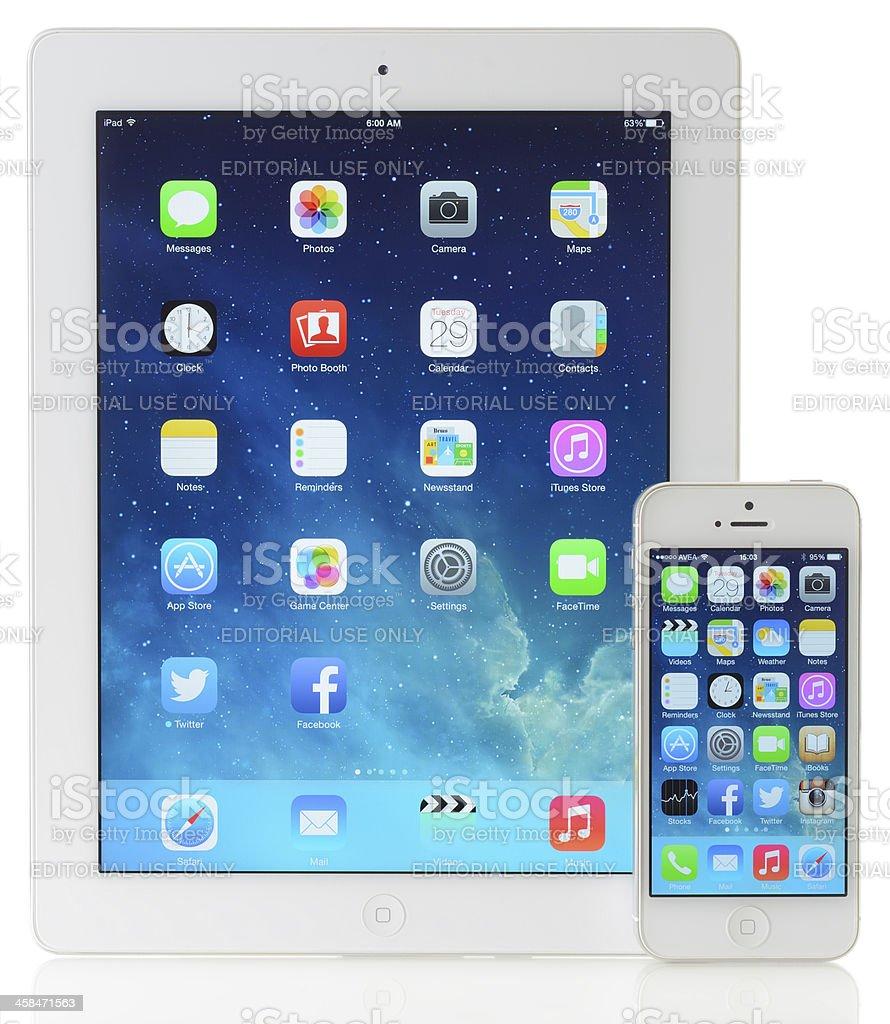 iOS 7 screen on Apple iPad 3 & iPhone 5 stock photo