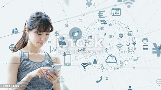 istock IoT (Internet of Things) concept. Asian girl using a smart phone. 1159996430
