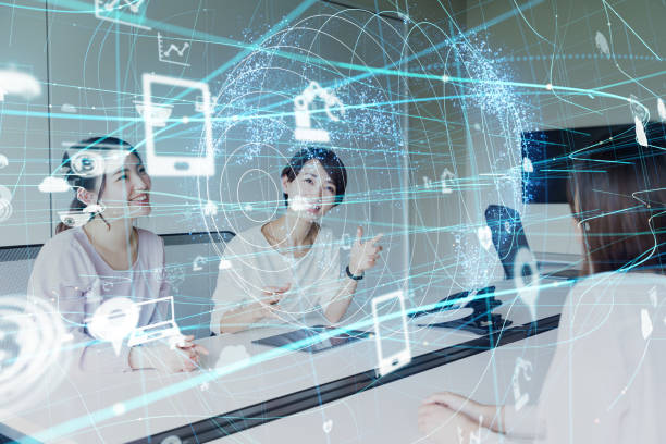 IoT (Internet of Things) concept. Group of asian businesswoman working in the office. stock photo